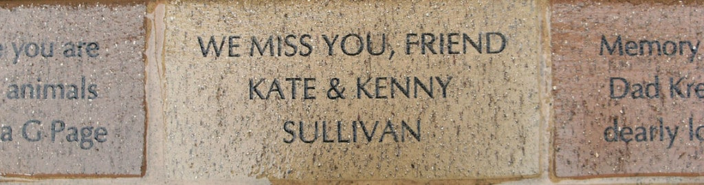 A memorial brick inscribed to Bill the Chimp with text that reads 'We miss you, friend. Kate & Kenny Sullivan'