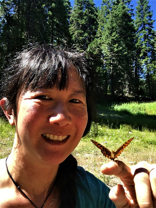 Chris Damiani with Oregon silverspot butterfly resting on her finger