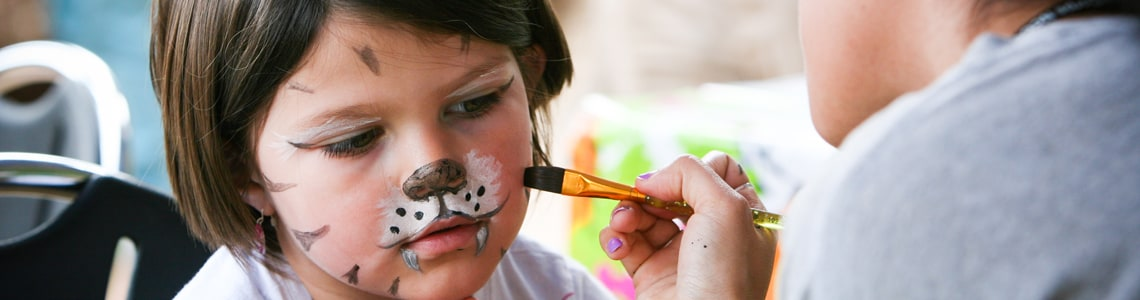 child having her face painted at sequoia park zoo